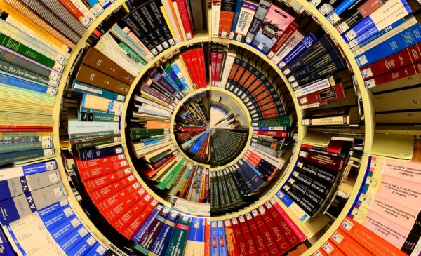 Birds-eye-view of colorful books in a spiral.