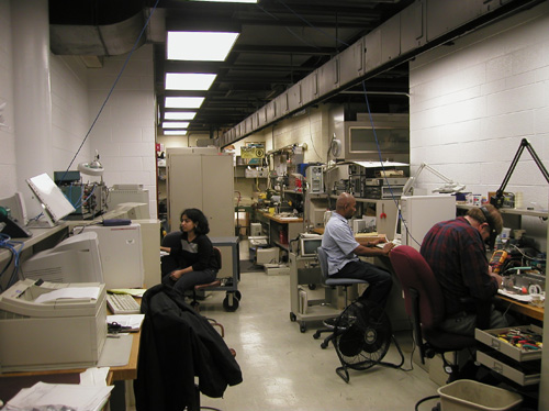 Staff working in the electronics shop